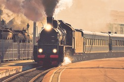 Vintage image of the departure of the retro steam train.
