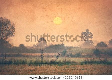 stock-photo-vintage-image-rural-landscape-countryside-at-dawn-223240618.jpg