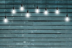 Vintage incandescent bulbs on blue wooden wall