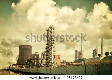 Vintage industrial landscape with chemical factory, pipes and smoke