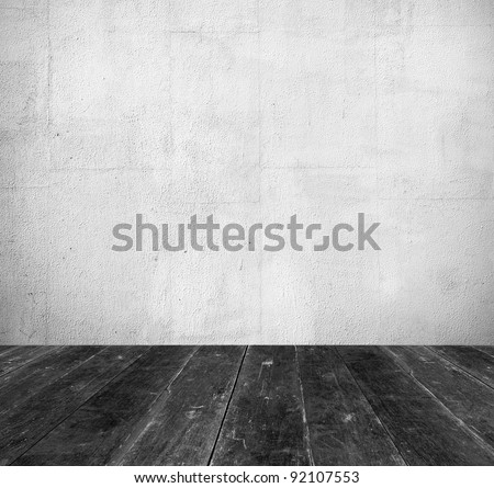 Vintage interior, grunge background of old room from white stone wall and black wooden floor