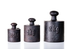 Vintage iron weights on the white background.