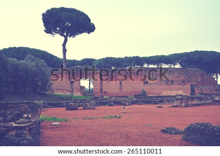 Vintage italy background. Rome vintage landscape with trees. Ancient rome buildings and constructions. Ancient ruins. Beautiful view with trees and ruins. Parks and recreation.