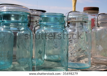 Vintage jars lined up on a table