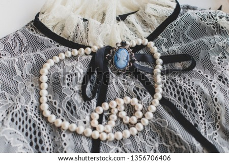 Vintage jewelry cameo brooch and lace dress #1356706406