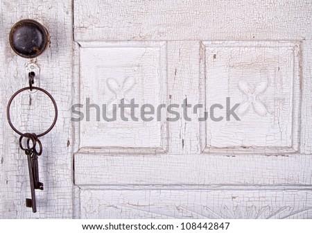 Vintage key unlocking an  old cracked antique or vintage door