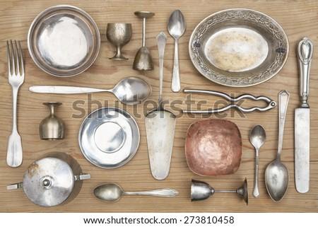 Vintage kitchen silverware  and utensils on a wooden background