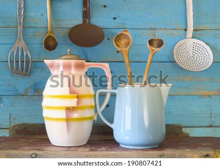 vintage kitchen utensils plus a cacao can and a milk mug