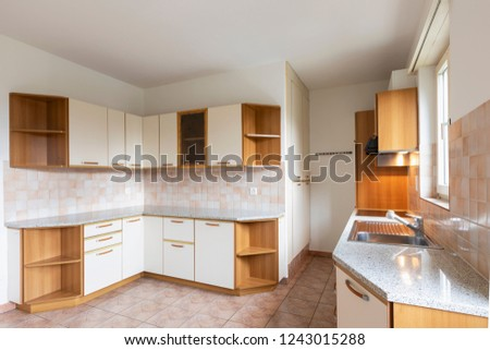 Vintage kitchen with wooden wall units. Nobody inside