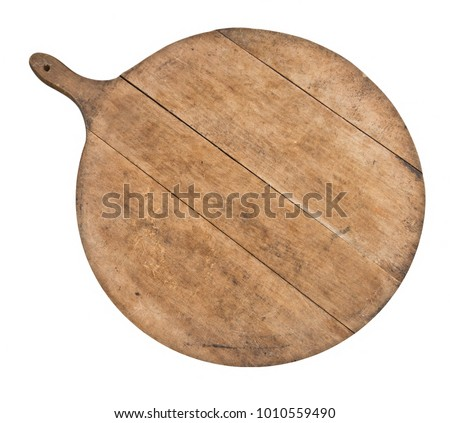 Vintage kitchenware. Genuine old wood cutting board, breadboard, isolated on white. Round (more or less) with handle. #1010559490