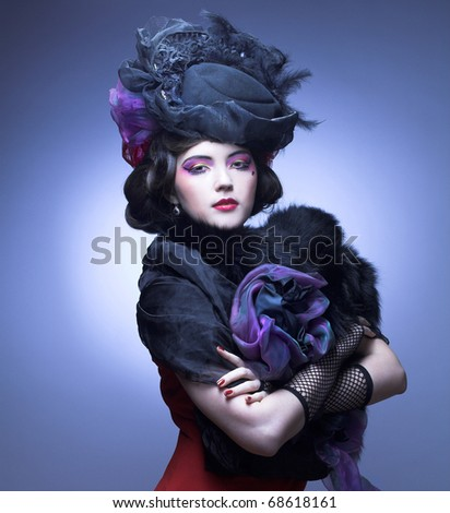 Vintage lady.Young pretty woman in black hat and furs.