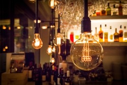 Vintage lamp bulb with bar or cafe night abstract background