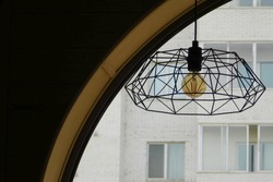 vintage lamp under an arch on the background of the house.
