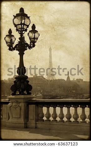 Vintage lamppost on the bridge of Alexandre III in Paris, France