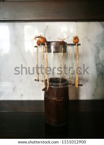Vintage lantern in the room.lantern to describe many types of portable lighting, but lanterns originated as a protective enclosure for a light source usually a candle or a wick in oil,to make it easie #1151012900