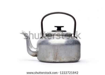Vintage large aluminum tea pot kettle stove top isolated on white background with clipping path