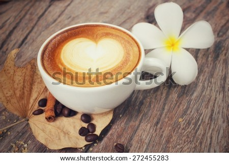 Vintage latte art coffee with flower