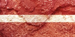 Vintage Latvia national flag icon pattern isolated on weathered solid rock wall background, abstract positive design faithful Latvian politics society concept texture wallpaper