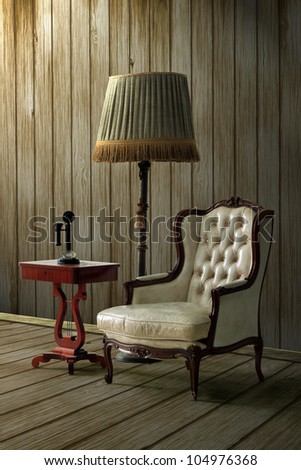 Vintage leather armchair and a retro lamp with wood wall background