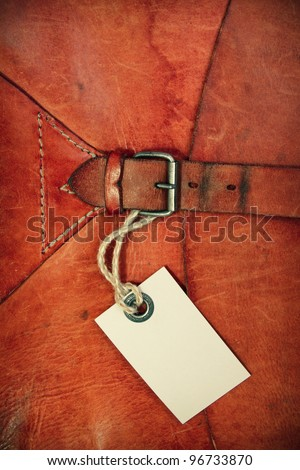 Vintage leather textured background with gift tag