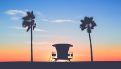 Vintage Lifeguard Tower at the Beach with sunset in background in San Diego, California