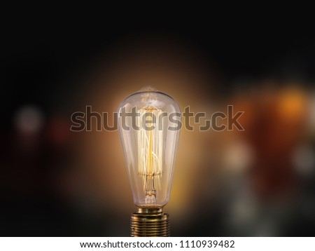 Vintage light bulb on dark background with empty space for text. #1110939482