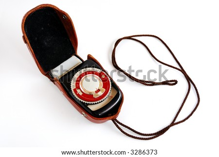 Vintage light meter in a leather case on a small strap