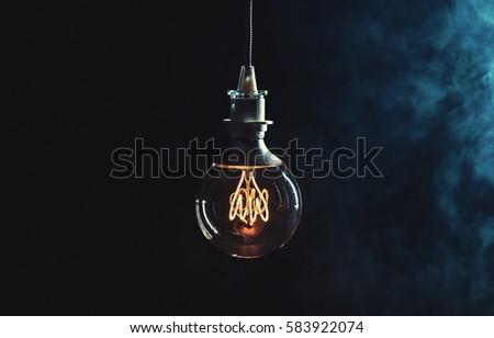 vintage lightbulb on dark...