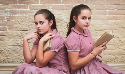 Vintage literature. Traditional education. Outdated approach. Literature lesson. Adorable students study literature together. Homeschooling concept. Sisters girls vintage dresses reading books.