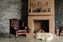 Vintage living room, retro style. Fur, leather armchair, fireplace, interesting bed with nice pillows and large windows