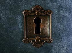 Vintage lock on swirled textured background