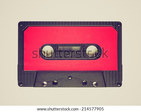 Vintage looking A vintage audio tape cassette isolated over white background