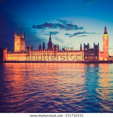 Vintage looking Houses of Parliament Westminster Palace London gothic architecture - at night
