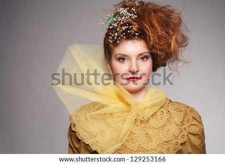 vintage looking portrait picture of young ginger woman