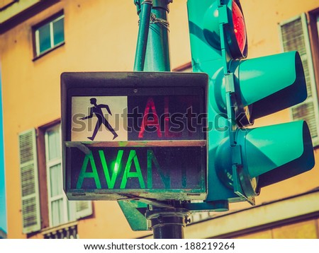 Vintage looking Traffic light for pedestrian crossing showing Avanti sign in green meaning Walk
