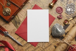Vintage Love Card on Top of Red Envelope Mockup with retro elements like wax seal and stamp, feather pen, heart box, ribbon, medallion, vintage sheets. Great for Valentine's Day and Romantic Projects.