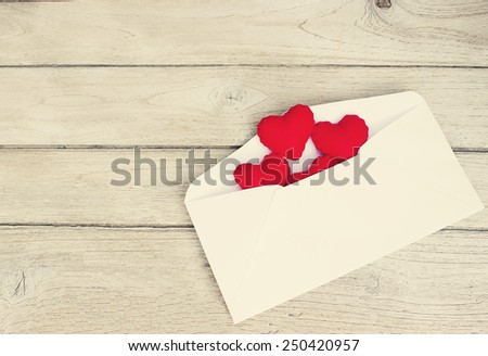 vintage love Letters,Red Hearts in a letter on wood