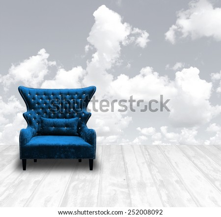 vintage luxurious armchair on wood panel at white pale with fluffy cloud sky background
