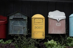 Vintage mailbox. Beautiful old-fashioned mailboxes black yellow red. Shabby weathered postbox set, background backdrop