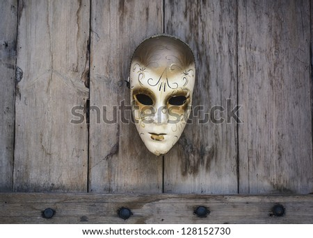 Vintage mask on wooden background