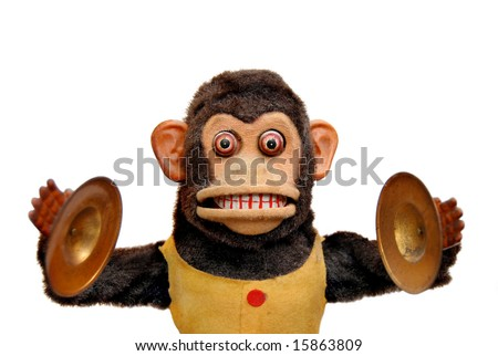 Vintage mechanical monkey toy with cymbals, isolated on white