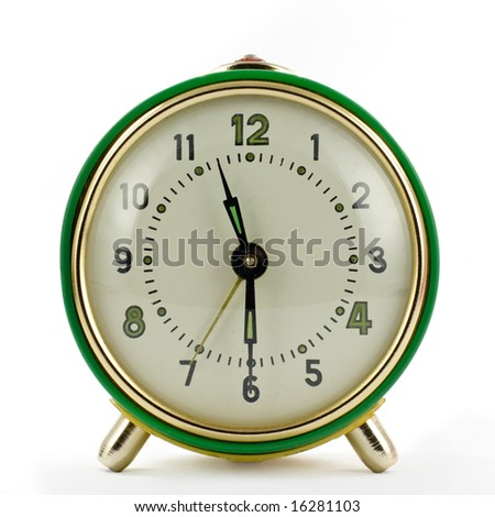 Vintage mechanical wind-up alarm clock over white isolated