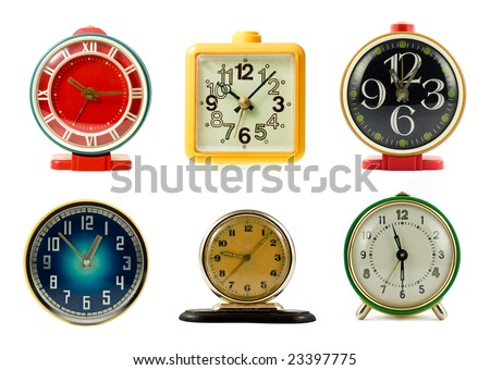 Vintage mechanical wind-up alarm clocks on white background