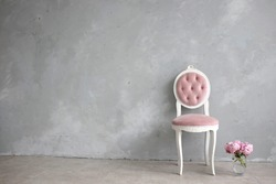 Vintage medallion chair tied with pink velvet in the technique of carriage tie. Interior design. Fine art. Copy spase.