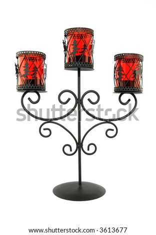 Vintage metal and glass candleholder on white background.