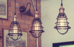 Vintage metal cap lamp hanging from the ceiling. (vintage style)