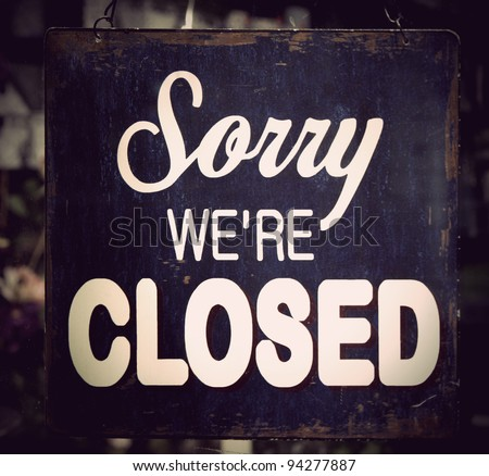 Vintage metal closed sign on shop door