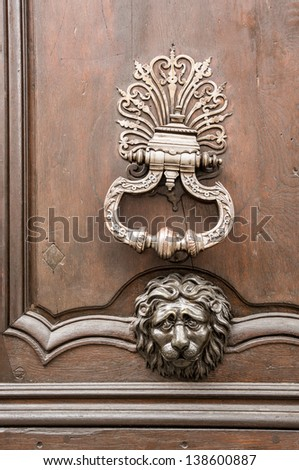 Vintage Metal Door Knob On A Wooden Door