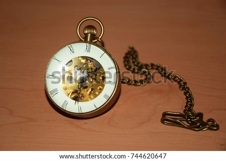 Stock Photo Vintage Metal Globe Clock with Round Magnifying Glass, Roman Letters, Cog Wheel and Chain - Pocket Watch Isolated Object - Time, Memories