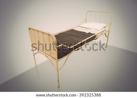 vintage metal hospital bed on...